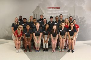 Parent Ambassadors in front of the Capstone Creed